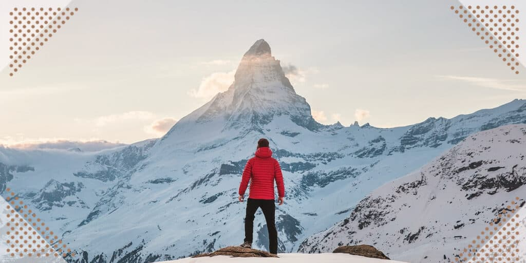 a man finding motivation on a mountain top